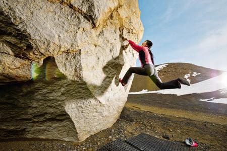rockclimber: Woman bouldering in Josepsdalur, Iceland LANG_EVOIMAGES