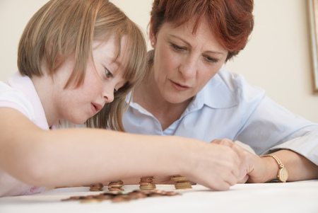 assembled: Mother and daughter counting coins