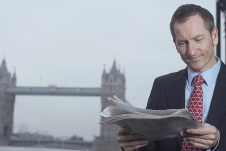 histories: Businessman reading newspaper