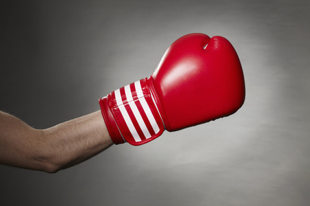 perilous: Hand wearing boxing glove