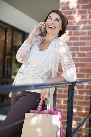 responded: Woman talking on cell phone outdoors