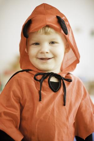 Smiling boy wearing devil costume