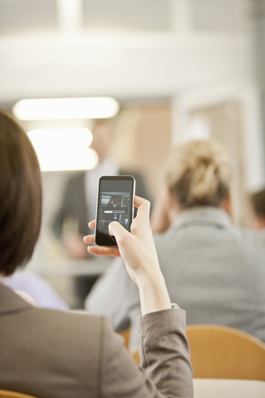 new age: Businesswoman using cell phone in office