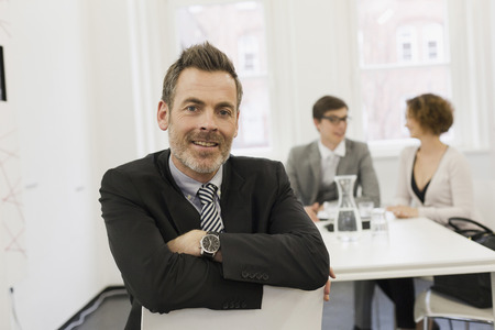 taught man: Businessman smiling in office