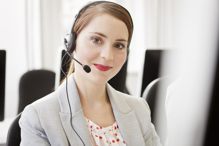 Businesswoman working in headset LANG_EVOIMAGES