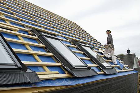abodes: Builder at work on new structure LANG_EVOIMAGES