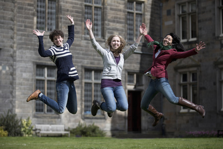 spirited: Students jumping for joy outdoors