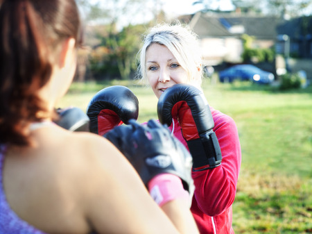 Boxer training with coach outdoors LANG_EVOIMAGES