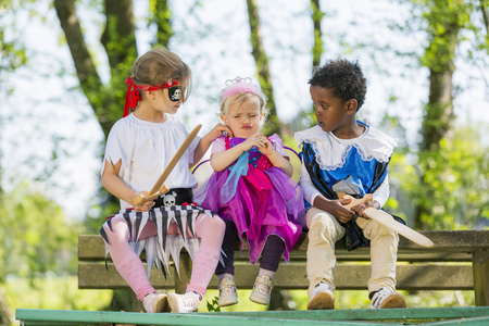 dressups: Children playing dress up outdoors LANG_EVOIMAGES
