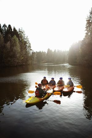 Teacher talking to students in kayaks