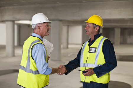 affiliation: Workers shaking hands on site