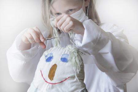 trashed: Girl cutting dolls hair