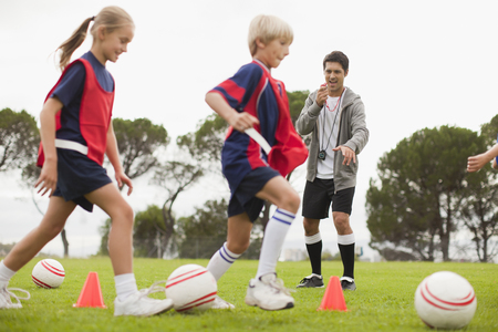 Coach training childrens soccer team