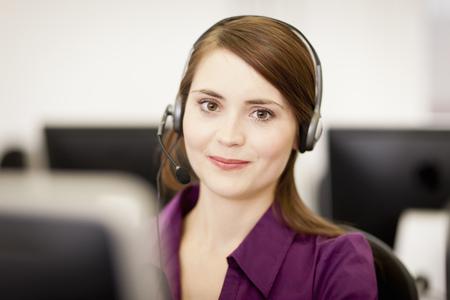 handsfree telephones: Businesswoman working in headset LANG_EVOIMAGES