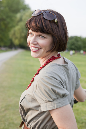 Smiling woman standing in field