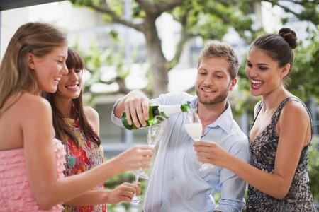 lavishly: Friends drinking champagne together LANG_EVOIMAGES