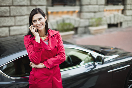 admired: Smiling woman talking on cell phone LANG_EVOIMAGES