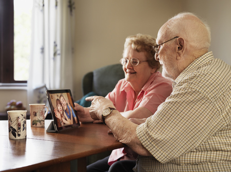 silver surfer: Older couple video chatting with family