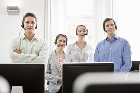 customer service representative: Business people working in headsets