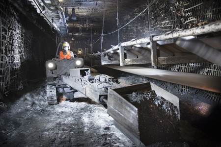 mined: Coal miner working in mine LANG_EVOIMAGES