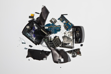 ravage: Pile of smashed cell phone parts