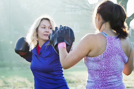 punched out: Boxer training with coach outdoors LANG_EVOIMAGES