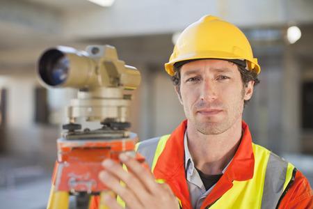 resolving: Worker using equipment on site