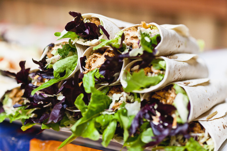 food: Close up of stack of cajun chicken wraps