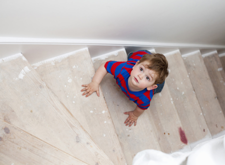 climbed: Toddler boy climbing steps LANG_EVOIMAGES