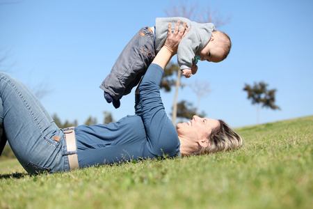 whimsy: Woman playing with baby in grass