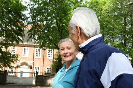 abodes: Older couple walking in park
