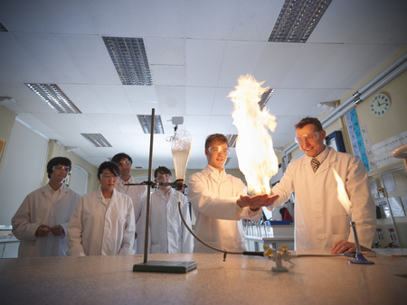 blazed: Chemistry teacher and students in lab