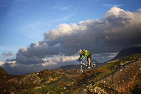Mountain biker on grassy hillside