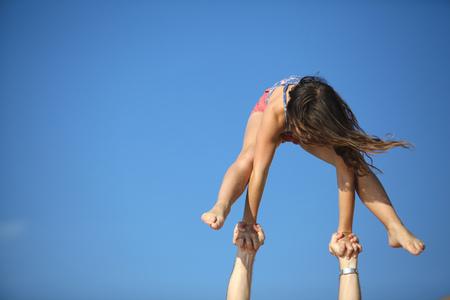 limber: Women doing gymnastics on beach