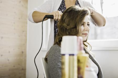 Woman having hair styled
