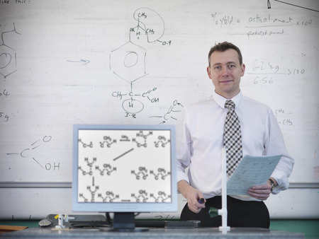 experimentation: Science teacher at desk with computer