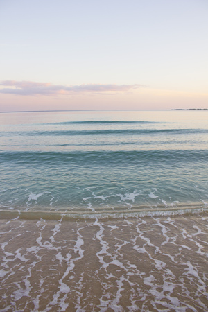 indies: Waves washing up on sandy beach