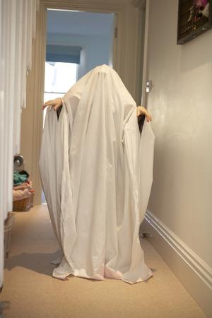 one sheet: Child wearing ghost Halloween costume