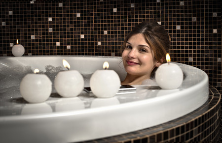 cleaned: Smiling woman relaxing in bath