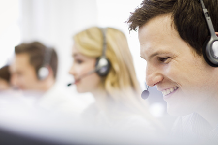 hands free device: Business people working in headsets