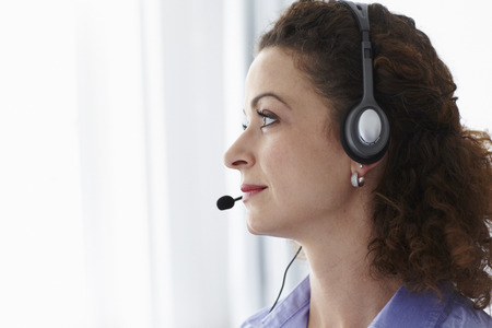 responded: Businesswoman wearing headset in office