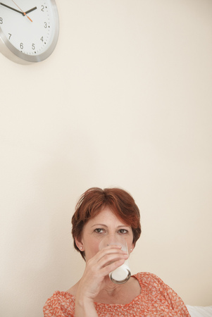 timepieces: Woman drinking glass of milk