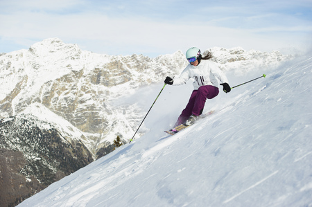 mountainous: Skier skiing on snowy slope LANG_EVOIMAGES