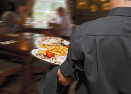 rushed: Waiter carrying plates in restaurant LANG_EVOIMAGES