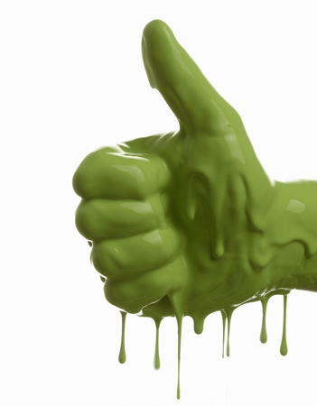 alright: Green painted hand making thumbs-up