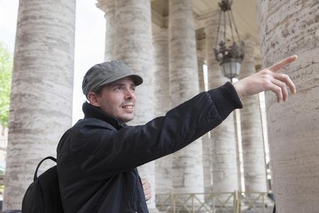 appendages: Man admiring architecture, St Peters Square, Vatican City LANG_EVOIMAGES