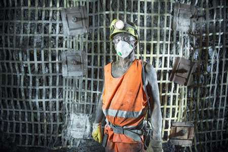 mined: Coal miner standing in mine LANG_EVOIMAGES