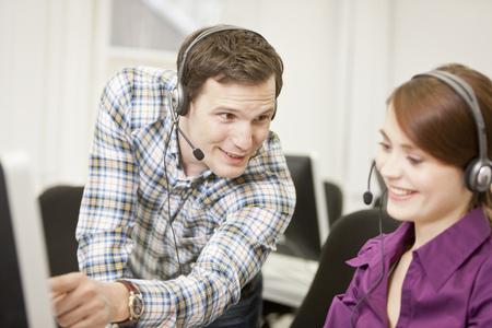 handsfree telephones: Business people working in headsets
