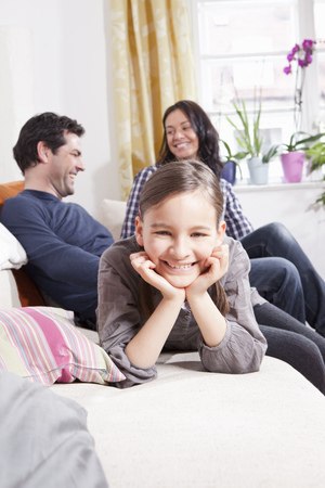 poppa: Girl smiling on sofa in living room