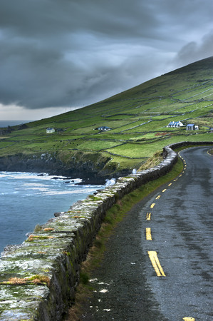 Paved road along rural cliffs